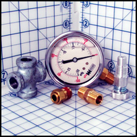 Regulator Assembly for vacuum pumps includes vacuum gauge, push-in fitting, relief valve, hex nipple and cross fitting