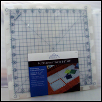Puzzlemat 24 in. x 36 in. set with case. Edges not included.